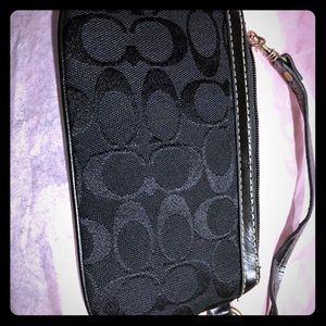 Faux coach black wristlet handbag